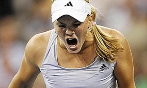 Oudin of the United States screams after winning a point in the second set against Wozniacki of Denmark during their quarter-final evening match at the U.S. Open tennis championship in New York