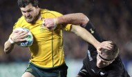 Australia's Adam Ashley-Cooper is tackled by New Zealand All Blacks Brad Thorn during their Rugby World Cup semifinal at Eden Park in Auckland, New Zealand, Sunday, Oct. 16, 2011.(AP Photo/Rob Griffith)